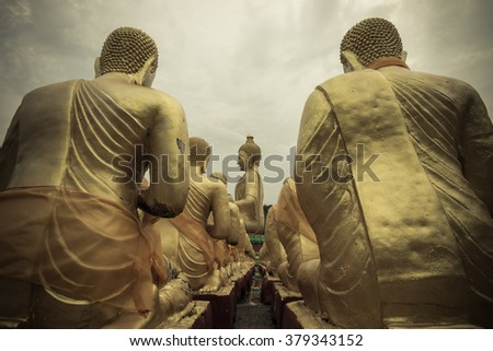 Big golden buddha and storm weather , abstract drama vintage style , center selective focus  - stock photo
