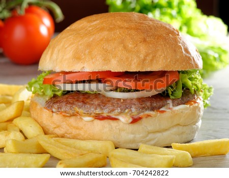 Big gourmet burger with chips