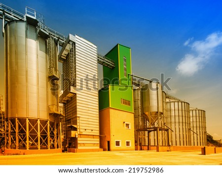 Big grain silos exterior on sunny day  - stock photo