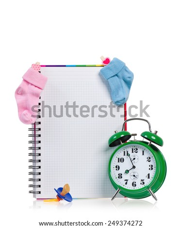 Big green alarm clock with blank notebook, isolated on white background - stock photo