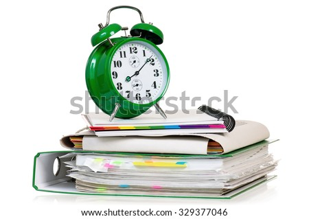 Big green alarm clock with folders, isolated on white background - stock photo