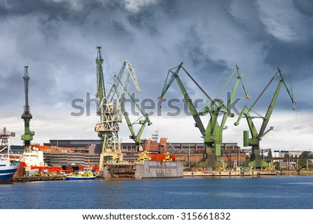 Big green cranes in shipyard of Gdansk, Poland. - stock photo
