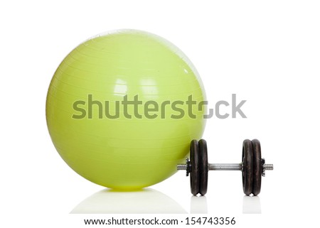 Big green training ball and dumbbell isolated on a white background - stock photo