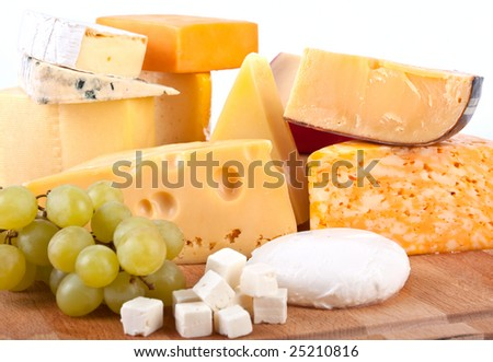 big group of cheeses with white grapes - stock photo