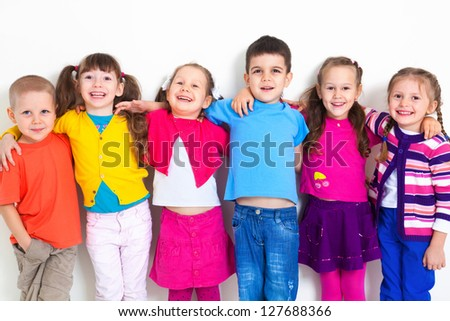 Big  group of diverse children  at  white wall - stock photo