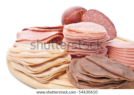 Big Group of Wafer Thin Sliced Meat Isolated on White Background - stock photo