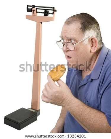 big guy about to eat a donut looking at scale - stock photo