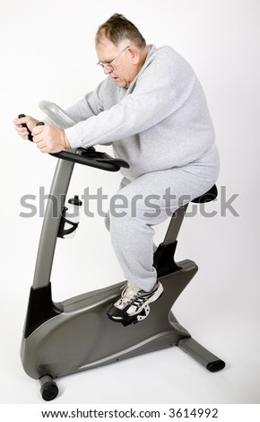 big guy works it off on a bike - stock photo