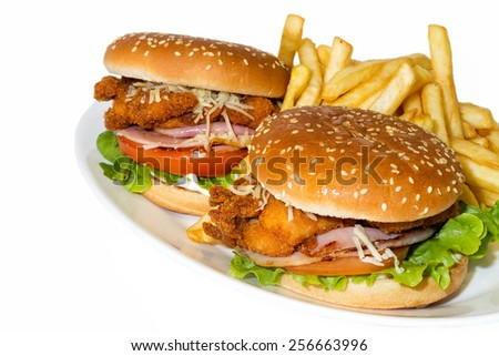 Big hamburger with chicken and french fries - stock photo