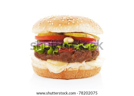 Big hamburger with fresh vegetables isolated on white. - stock photo