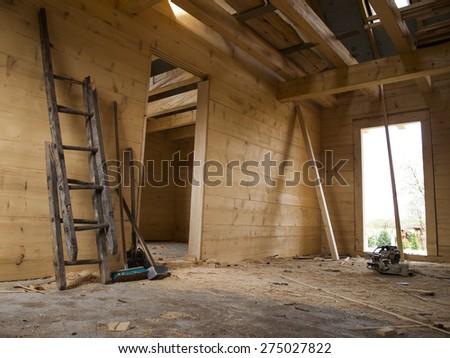 big hammer, broken wooden ladder, shovel and brush in a wooden house built - stock photo