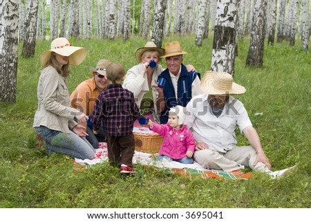 big happy family - mother, grandmother, father, daughter, son, grandfather, great-grandfather at the forest - stock photo