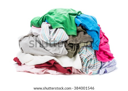 Big heap of colorful clothes isolated on white background - stock photo