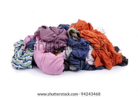 Big heap of colorful clothes on white background - stock photo