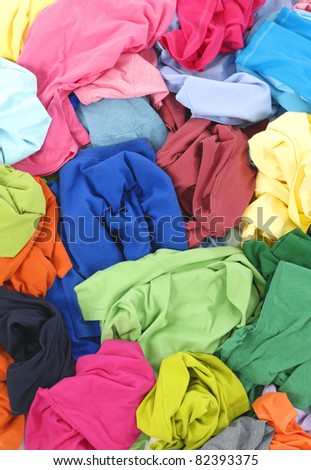 Big heap of colorful shirt clothes - stock photo