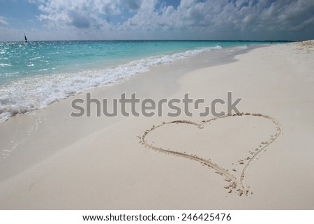 Big heart on the white sand beach