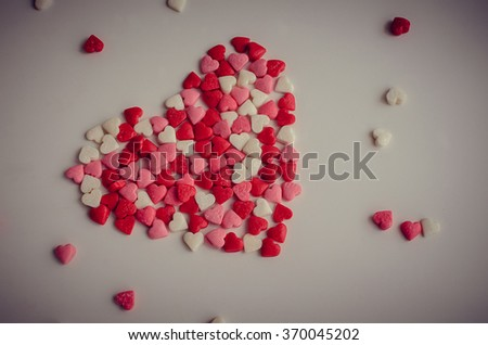 Big heart with little red, pink and white hearts on light background. Empty space for text. Valentines Day background. Valentine's Day theme. Romantic love background. Toned image. - stock photo