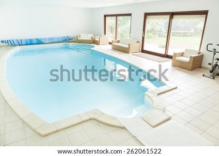 Big home swimming pool with granitic tiles - stock photo