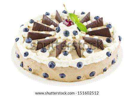 Big homemade mousse au chocolat or chocolate cream tart on a cake plate isolated on white - stock photo