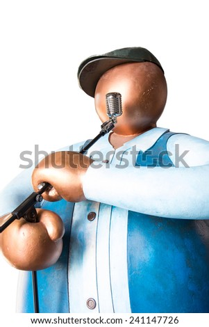 Big human toy sing a song and holding microphone on white background isolated - stock photo