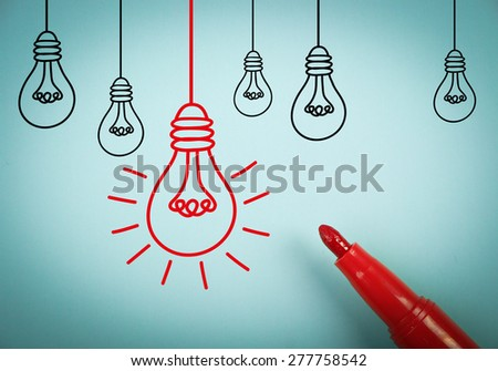 Big idea concept is on blue paper with a red marker aside. - stock photo