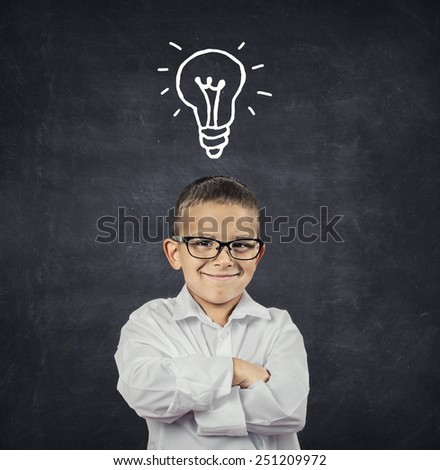 Big idea. Smart boy with solution lightbulb above head  - stock photo