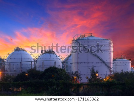 big Industrial oil tanks in a refinery at twilight - stock photo