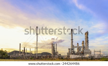 Big Industrial oil tanks in a refinery with treatment pond at industrial plants - stock photo