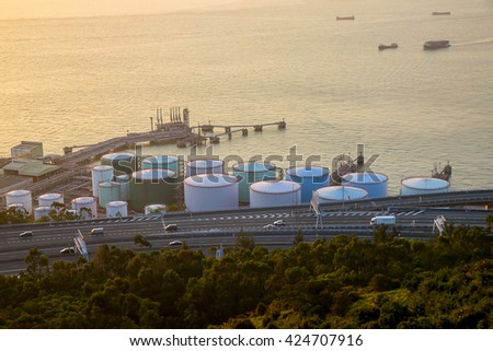 Big Industrial oil tanks in a refinery with treatment pond at industrial plants. - stock photo