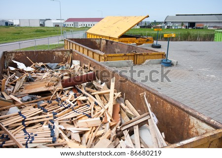 Big iron dumpster with ground-wood  at a refuse dump - stock photo
