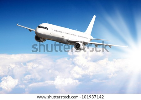 Big jet plane flying above clouds - stock photo