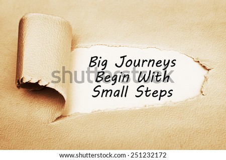 Big Journeys Begin With Small Steps written behind a torn paper