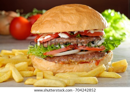 Big juicy double burger with french fries