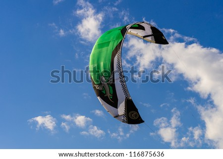 Big kite in the blue sky with some clouds - stock photo