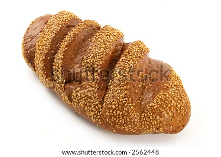 Big long loaf of rye bread with seeds
