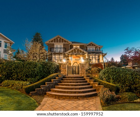 Big Luxury House At Dusk Night Time In Suburbs Of Vancouver Canada
