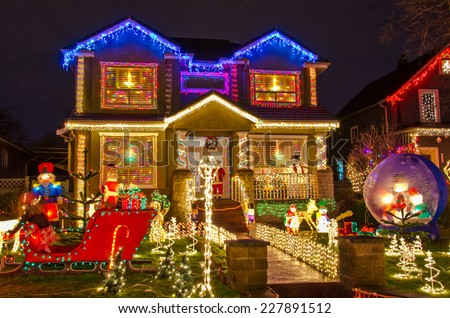 Big luxury house decorated and lighted for Christmas and for New Year Eve at Night at Vancouver, Canada. - stock photo