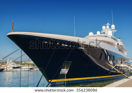 big luxury yacht moored in a marina - stock photo