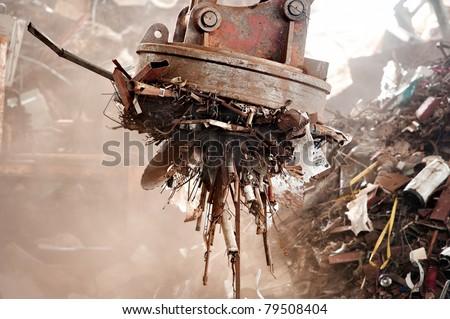 Big magnet in junk yard - stock photo