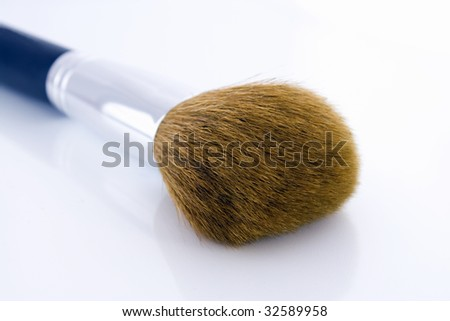 Big make-up brush for face powder or foundation. - stock photo