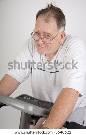 Big making the best of it working out on a bike - stock photo