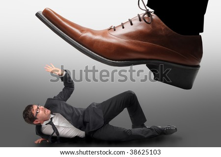 big male shoe stepping on a little businessman - stock photo