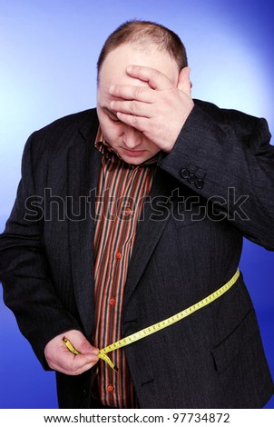 big man with measuring tape - stock photo