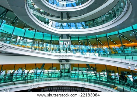 Big maze stairway in glass office building - stock photo