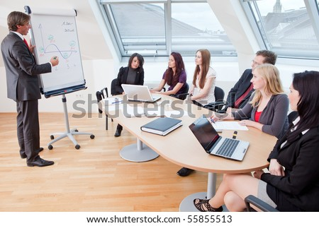 big meeting at the round table in the office - stock photo