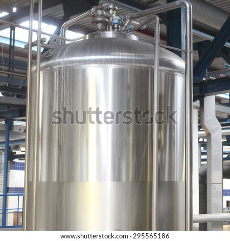 big metal tank with the glass hatch - stock photo