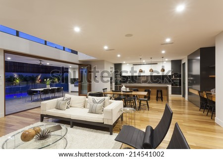 Big modern home with kitchen, living room and outdoor area - stock photo