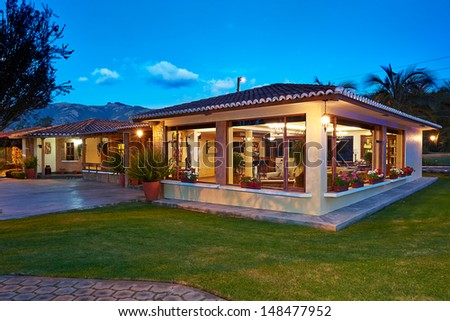 Big modern house at night - stock photo