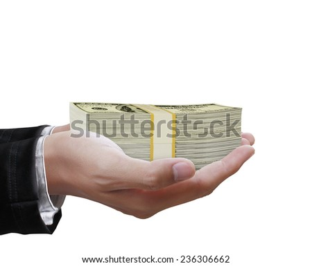 Big money in the hand from business - stock photo