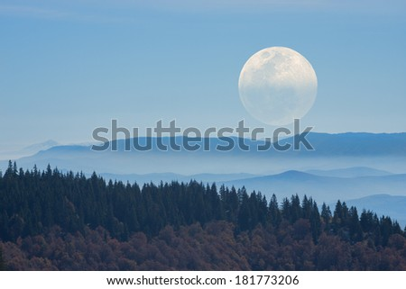 Big Moon rising above the distant mountains. Mosaic photo. - stock photo